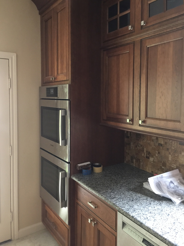 Dual oven with cherry cabinets in kitchen remodel