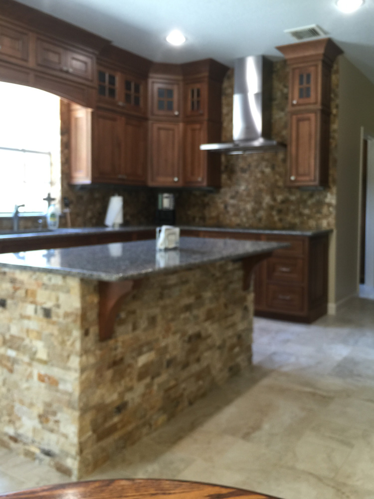 Kitchen remodel with island and cherry cabinets