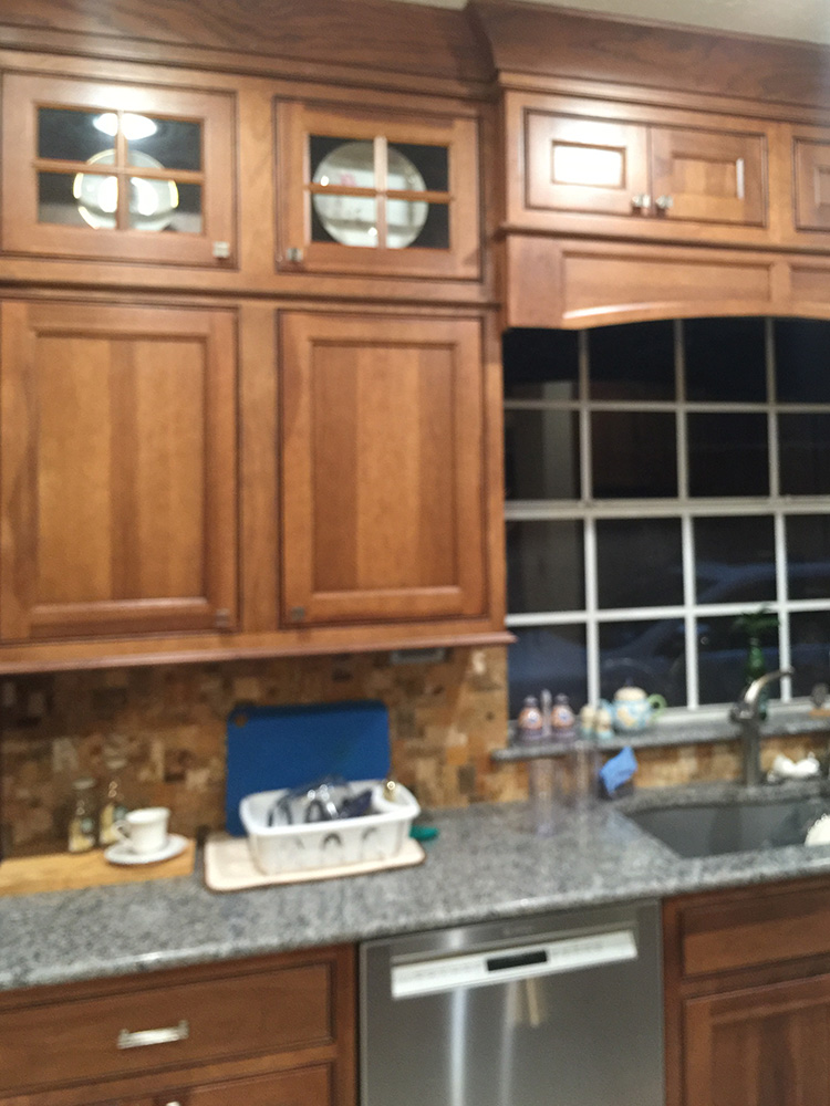Fully functional kitchen remodel with stainless appliances and walnut cabinets